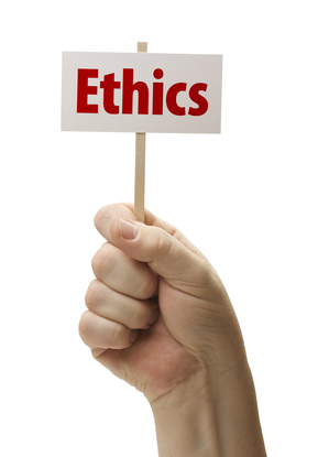 Ethics Sign In Male Fist Isolated On A White Background.