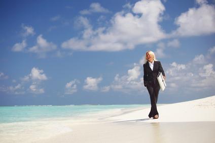 business woman on the ocean coast