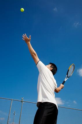 Asian playing tennis